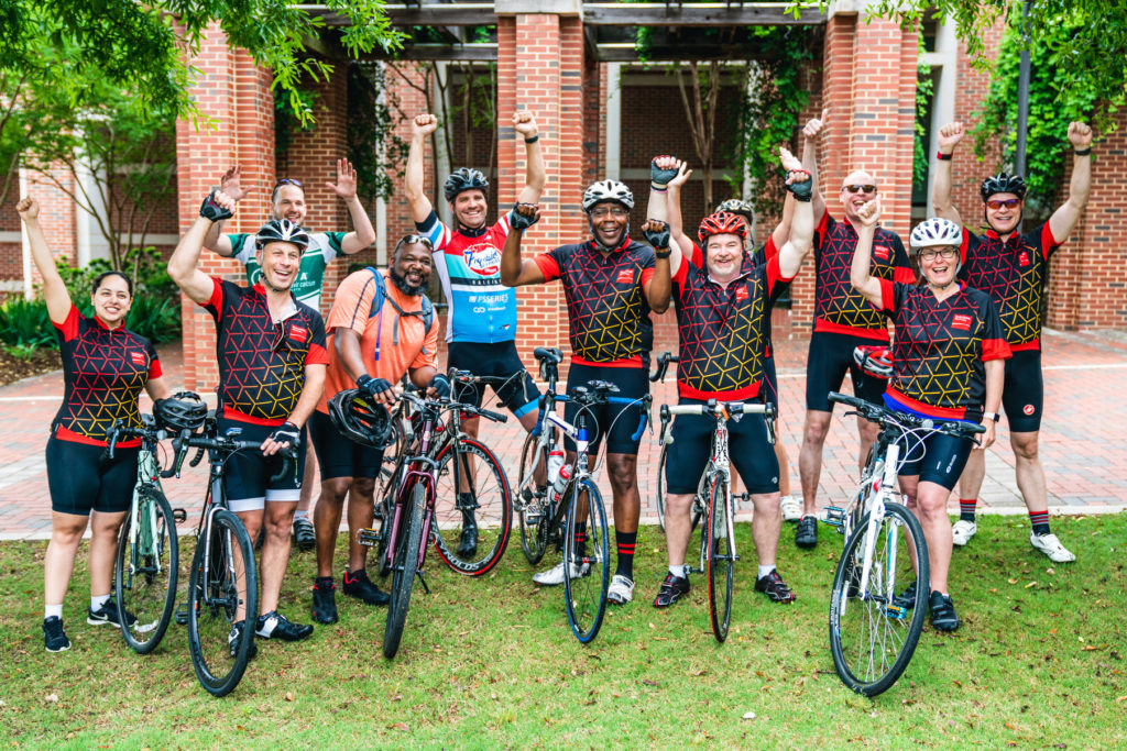 Riders celebrate finishing the Victory Ride