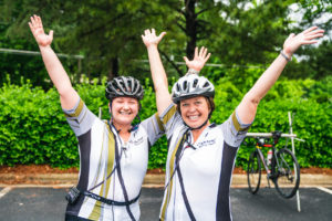 Two women from Team Wake Forest pose during the ride