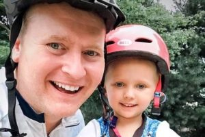 Father and daughter in helmets